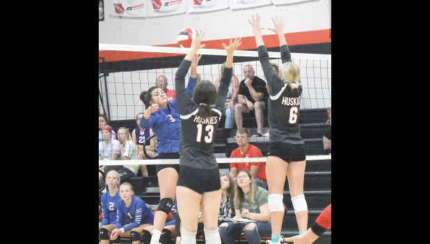 N-K's Marli Backhaus goes up against two Huskie defenders in last Tuesday's 3-2 TIC East loss. After seven matches this season Backhaus leads the team with 34 kills and 14 blocks.