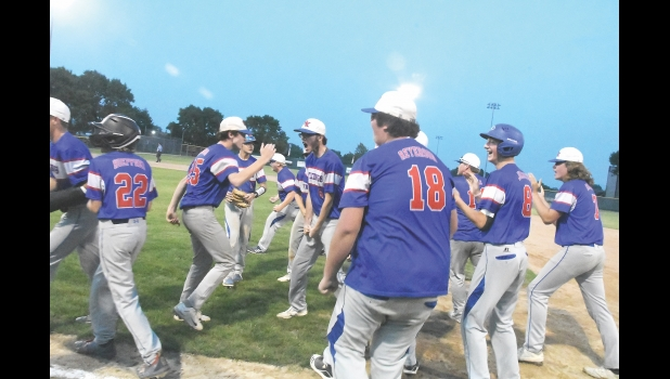 The Vikings bench rushes onto the field to celebrate the team's Cinderella season, going from a six seed at 13-14 to beating the No. 1 team in the state and being crowned district 3 champions.  See page 12 for more sports.