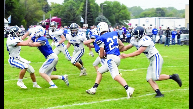 Viking defenders Treycen Rollene (12), Josiah Kliment (22), Drake Tiedemann (34) and Tyler Mills (35) pursue a Harris-Lake Park ball carrier in the 32-29 district win.