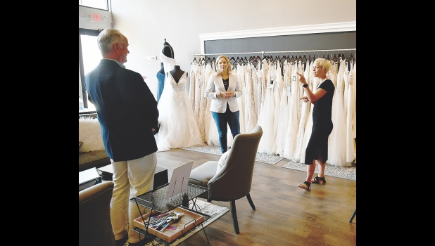 Representative Ashley Hinson is pictured speaking with Brittany Low, owner of Fringe & Lace in Northwood, along with Brook Boehmler, regional director of the Iowa's SBDC (Small Business Development Center).