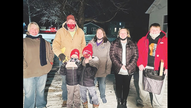 "Pictured are event organizers Tracy McCoy and Kris Ritzert with the family of Kelyn Meyer, the seven-year-old boy who was named a ""hero"" of the event, and who received assistance for his ongoing expenses."