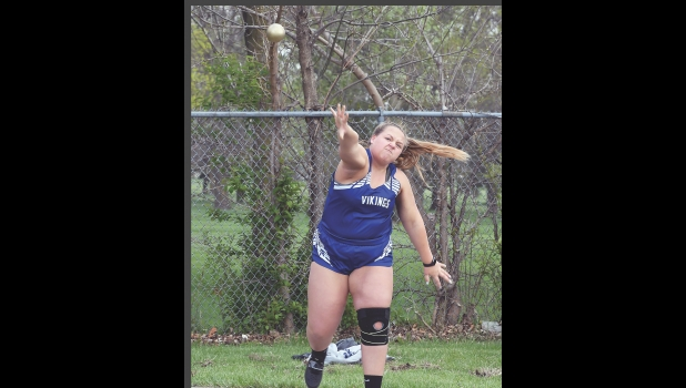 Lady Viking Teagan Johnson throws the shot in last Thursday night's TIC East Meet held in Manly. Johnson placed 13th in the event with a throw of 26-02.