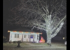 An evening drive through the city of Northwood provides a look at several shining examples of lighted holiday decorations of all kinds. Pictured above are just two of the bright efforts in Northwood.