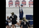 Lady Viking Ruthie Conlin blocks a N-P shot in last Tuesday's 3-1 loss to the Huskies. Conlin had six blocks and two kills in the TIC East loss.