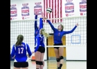 Natalie Cordle and Brylee Hoeppner defend the net in last Friday night's inter squad scrimmage. Cordle and Hoeppner combined for 121 kills and 73 blocks last season.