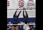 Olivia Stilley and Brylee Hoeppner team up to defend the net in last night's 3-0 win over RRMR.