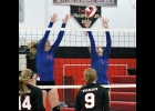 N-K's Peyton Pangburn and Brylee Hoeppner go up to block a Riceville shot in last Tuesday's 3-0 (25-15, 25-11, 27-25) win over the Wildcats. Hoeppner leads the team this season with 11 kills.