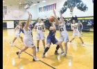 Lady Viking Olivia Stilley takes the ball down low against North Butler last Tuesday night in Greene. Stilley helped the team on the boards last week pulling down 10 rebounds in two games.