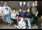 Mike Simmons: You can't tell who has Osteogenisis Imperfecta just by looking at them. Here is my family, me; my daughter-in-law, Lexi; granddaughter, Kaylynn; son, Justin; daughter, Tara; wife, Della; and seated in front, grandson, Jayce. Of all pictured only me (33 fractured bones), Kaylynn (6 fractured bones), Justin (27 fractured bones) and Tara (13 fractured bones) have OI. The only thing that distinguishes someone with OI from others that is noticeable is the whites of our eyes, the sclera, which is bl