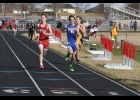 Anchor Thomas Block stretches for a third place finish in the 4x800-meter relay last Tuesday in Saint Ansgar. Block and his teammates, Ben Yezek, LaMonte Sims and Nathan Hanneman, finished with a time of 1:49.95, earning the team six crucial points.