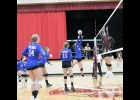 Lady Viking Olivia Stilley taps the ball back over the net in last Tuesday's TIC East loss at Newman. Stilley had six assists and three kills in the 19-25, 25-20, 23-25, 23-25 loss.